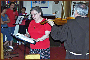 Sister Anna singing accompnied by 