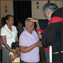 Father Peter blessing woman