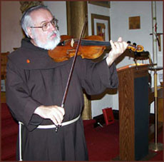 Father Peter playing the violin